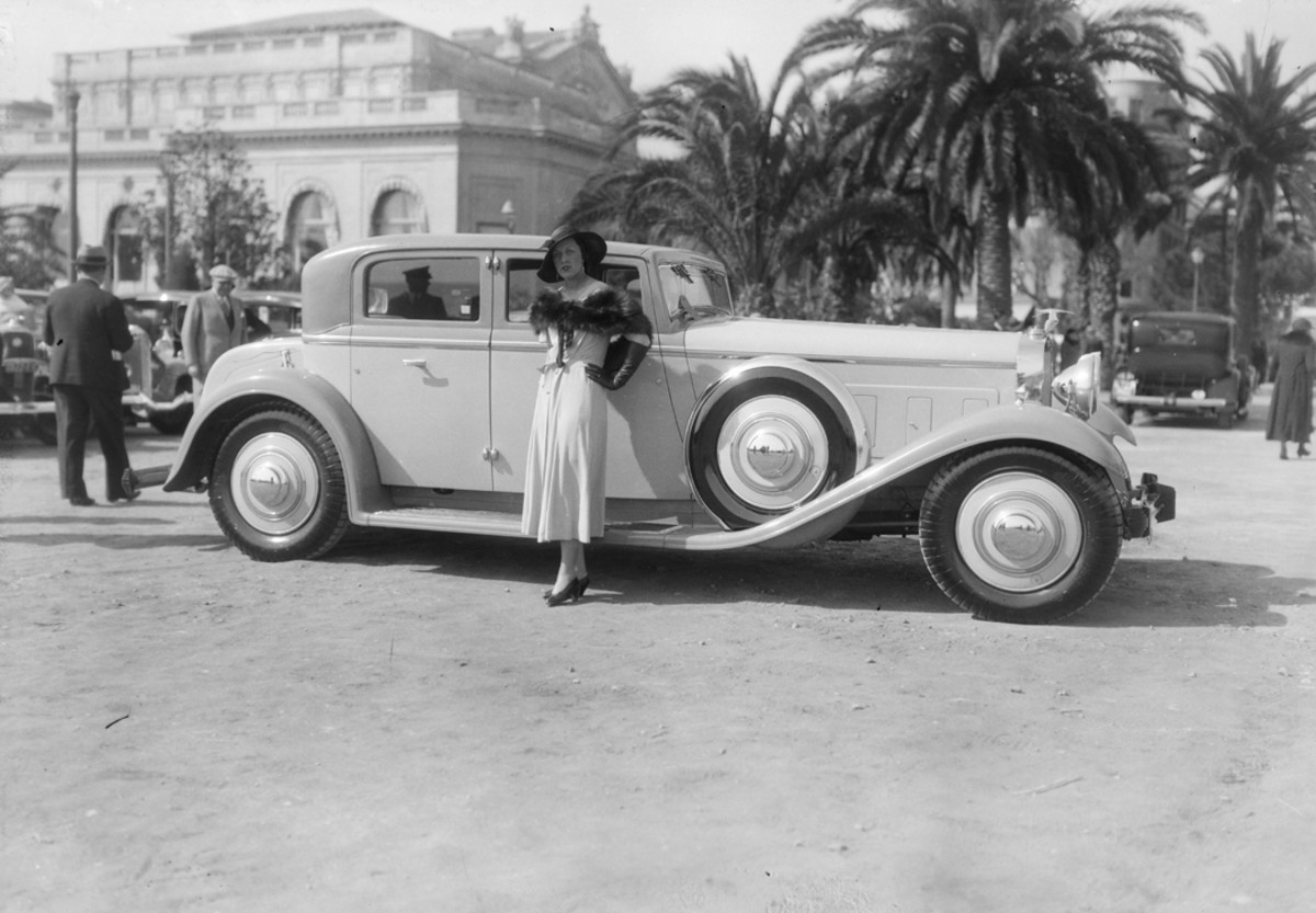 Madame Stavisky, the wife of notorious French embezzler Alexandre Stavisky, pictured at an automobile elegance competition in Cannes, France, during 1934, the year in which her husband's crimes were exposed.