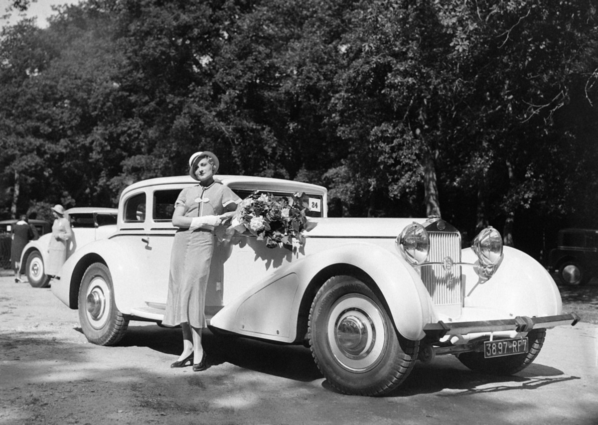 """The streamline era of sleek fenders met the Classic era of upright grilles on this Delage D8S coach shown at the 1932 concours d'elegance at Fontainebleau, France. Note the French Romo """"safety bumper"""" on the front of this car."""
