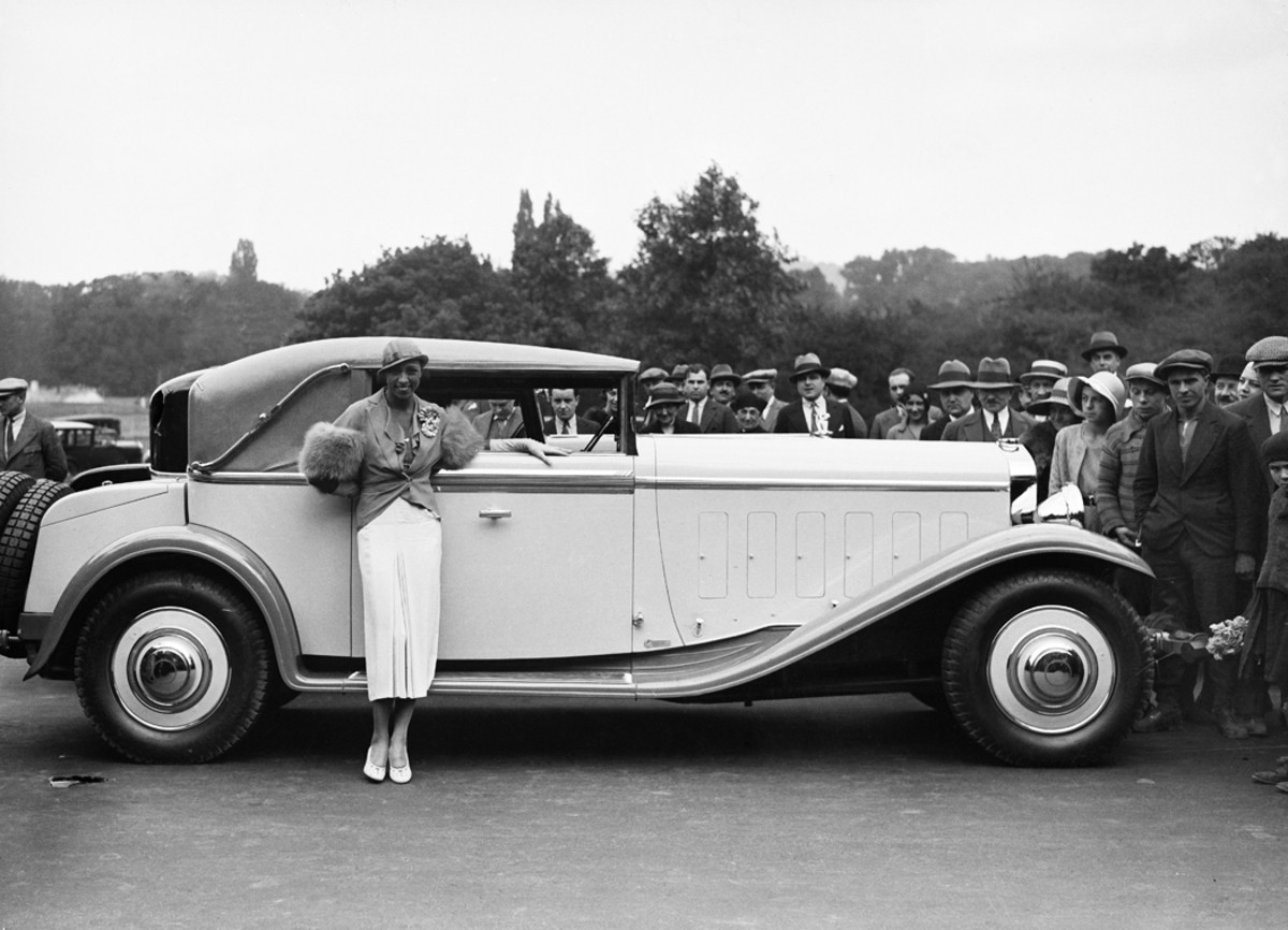 American-born Josephine Baker was a celebrated entertainer and later an agent for the French resistance during World War II. As an influential black woman, she also put her celebrity toward advancing civil rights. In a lighter moment, she stands beside a coachbuilt Delage convertible victoria at a French concours d'elegance in Auteuil during 1931. Unusual features of this body include its central door handle and its beltline molding of two different widths.