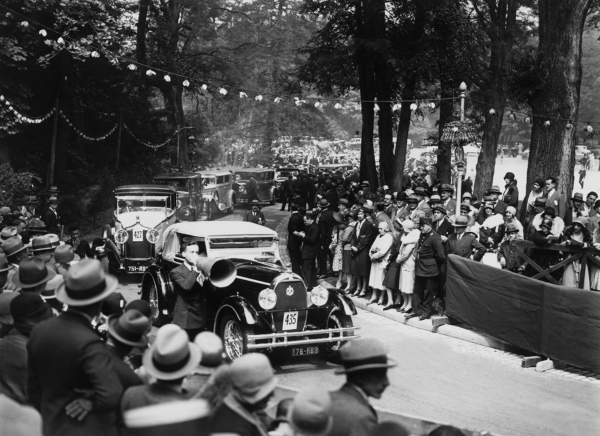 """A striking Bugatti leads a parade at a what is simply described as a """"motor elegance contest"""" in Paris during June 1929."""