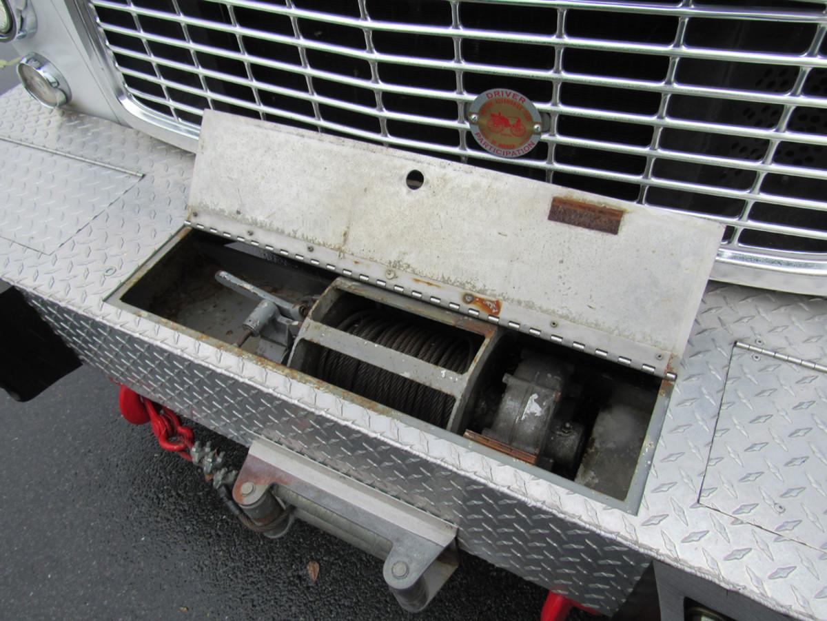 A winch is hidden in bumper.