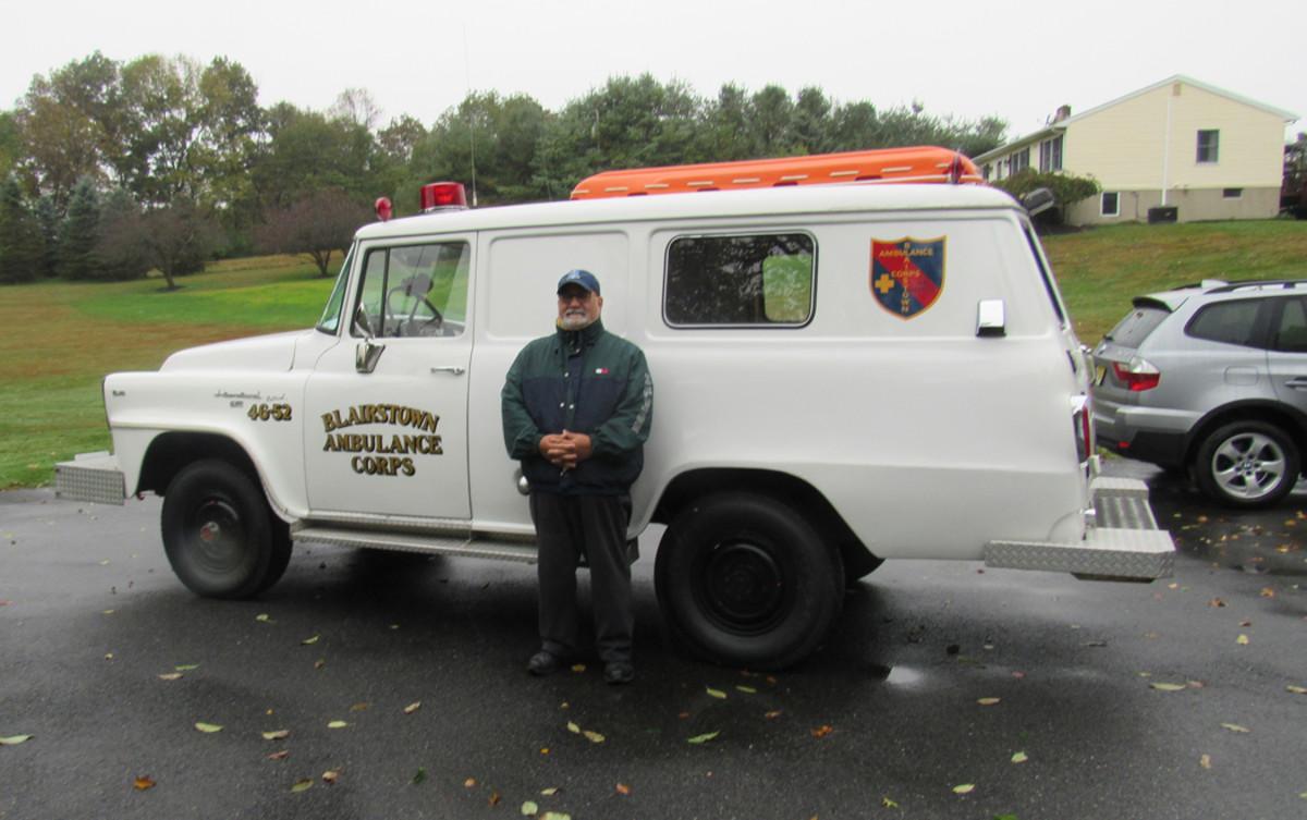 Joe DiGrazia next to his 4x4 ambulance.