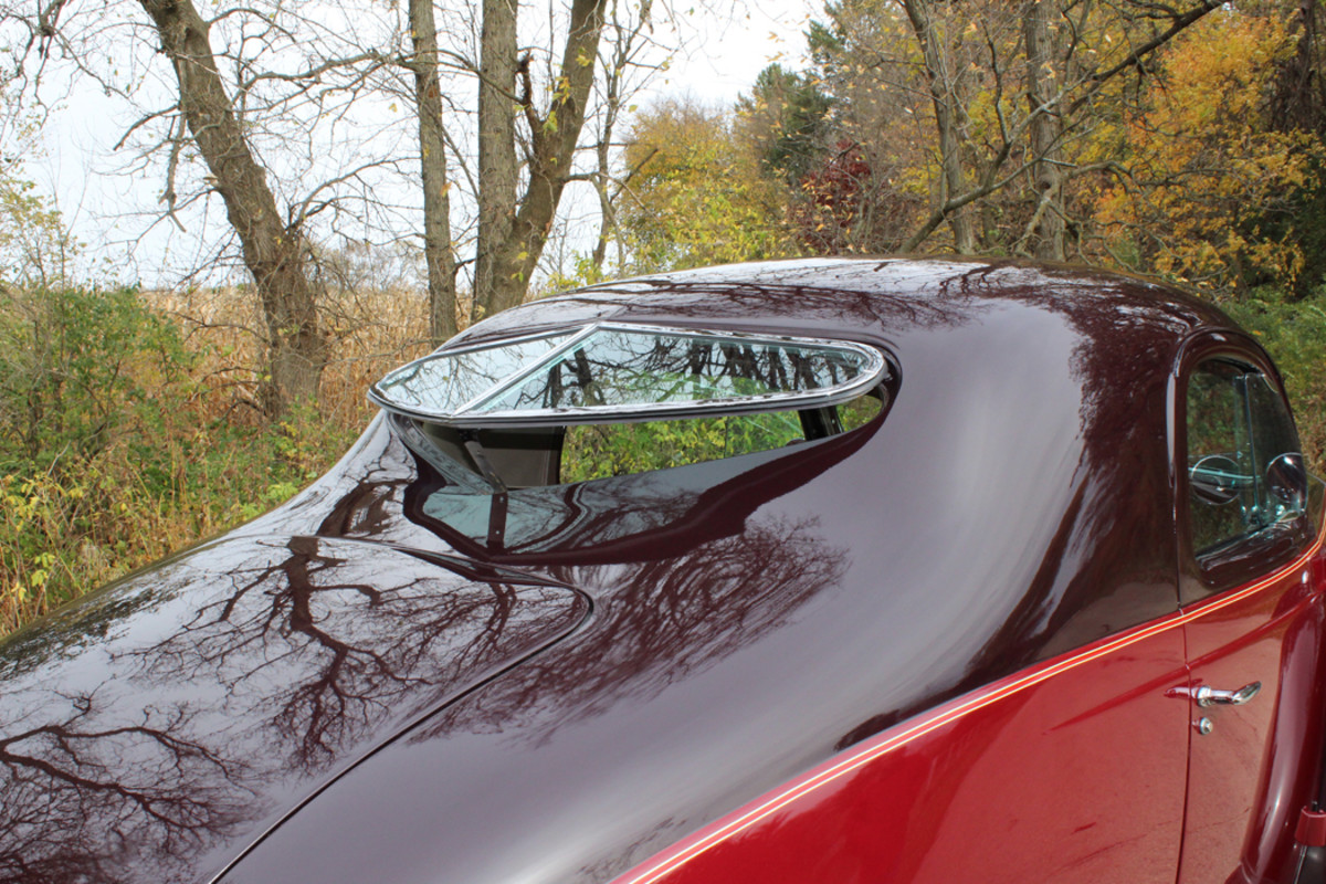 The cool heart-shaped rear window in the sloping roof tips out to increase ventilation.