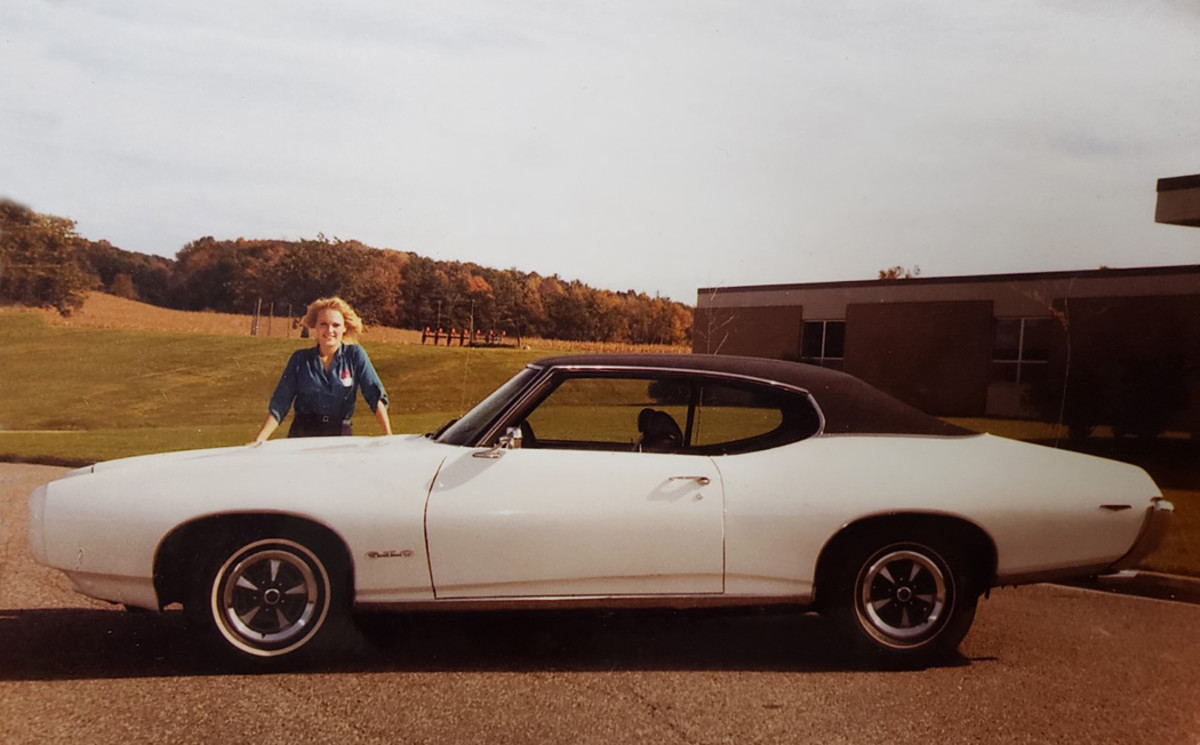 Denise posing with the '69 GTO after it was first restored.