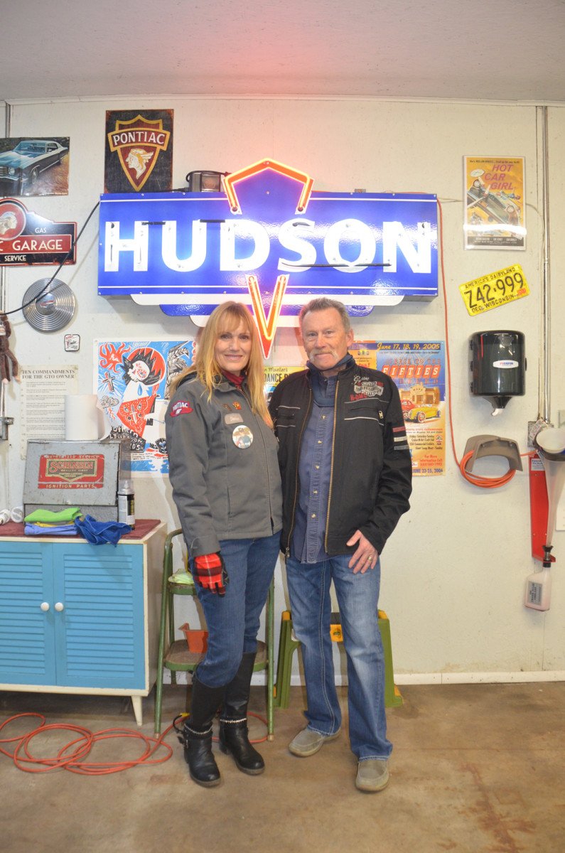 Denise Clumpner and Jesse Fisher beneath the neon that originally hung over their table at the Hudson's restaurant where they went on their first date.