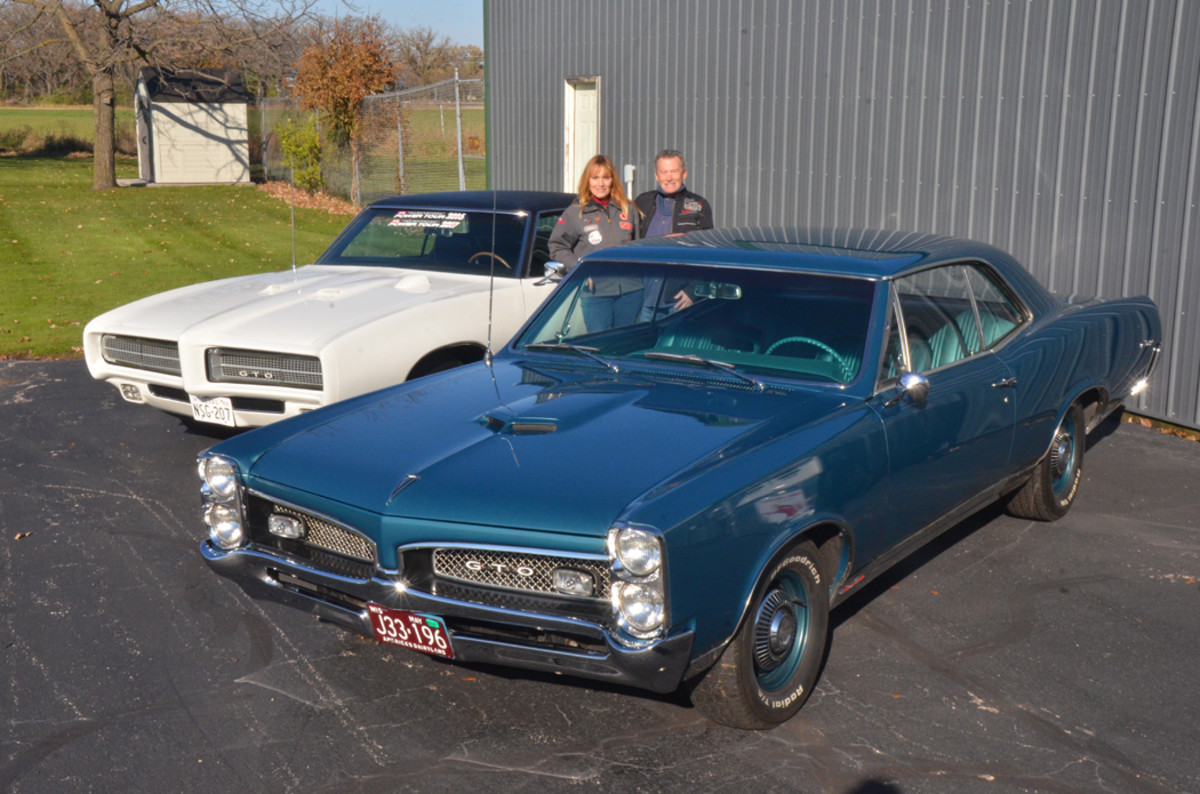Denise Clumpner with her 1969 Pontiac GTO and Jesse Fisher with his '67.