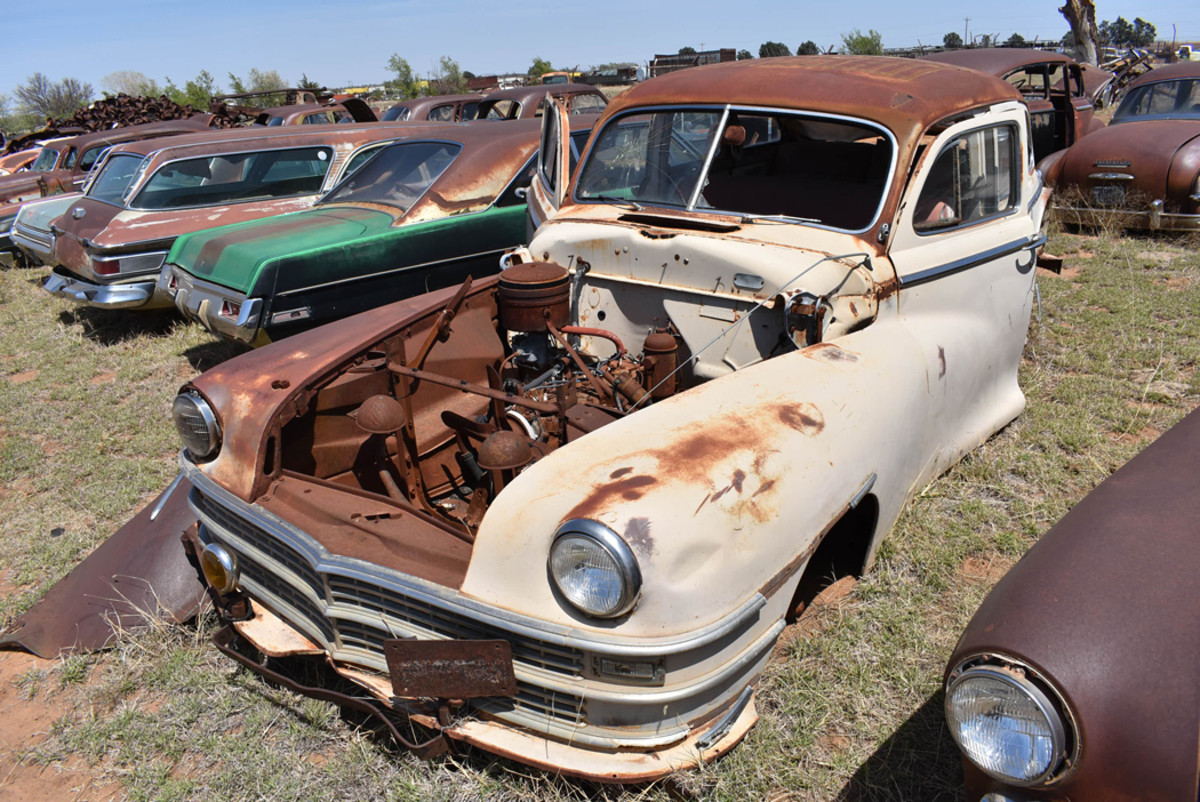 Plenty of choice parts are still available on this 1947 Chrysler Windsor sedan sitting under Texas skies.
