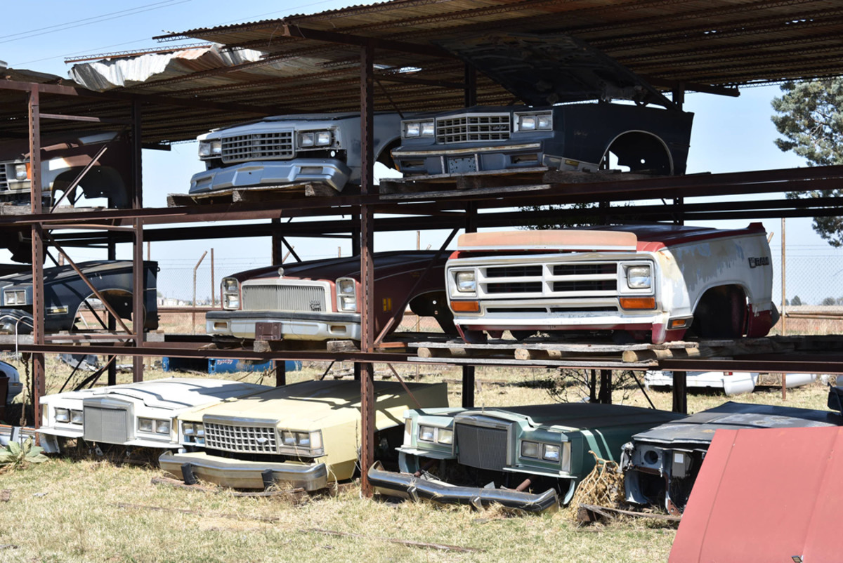One of several racks found at Owens Auto Salvage filled with complete front clips. This grouping has 1970s through 1980s front clips.