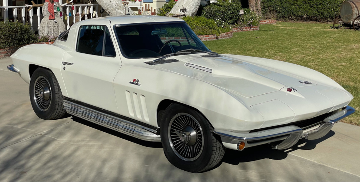 A fully restored 1966 Chevrolet Corvette #258 received a frame-on restoration 3,900 miles ago. It has a numbers-matching 427/425hp engine along with a Muncie 4 speed manual transmission, power steering, power brakes, side pipes, knock off wheels with new tires, leather interior.