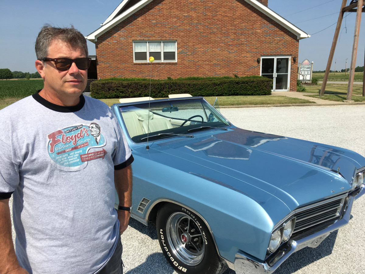 Scott Starkey with the 1966 Buick Skylark convertible that his parents bought in 1969.