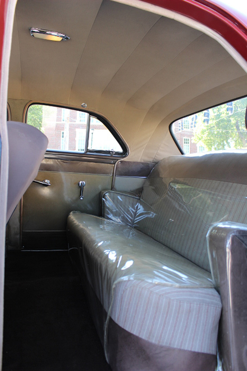 Clear plastic covers installed by the previous owner protect the original upholstery on the seats and door panels.