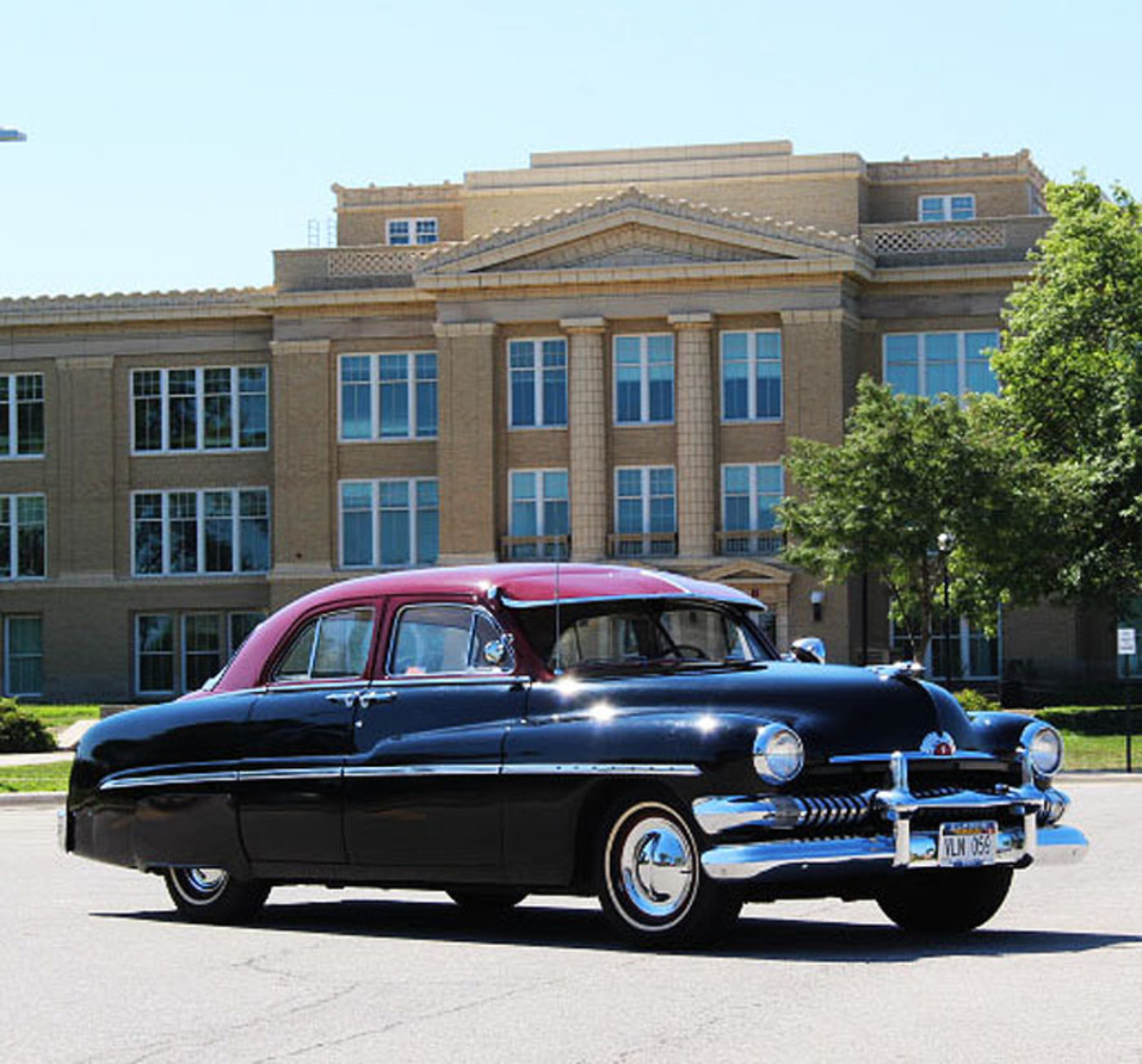 Bob Hubbard fell in love with a 1951 Mercury sedan while in high school. This is neither the same Mercury nor the same school, but is certainly a fitting background for Hubbard's history with his 1951 Mercurys.