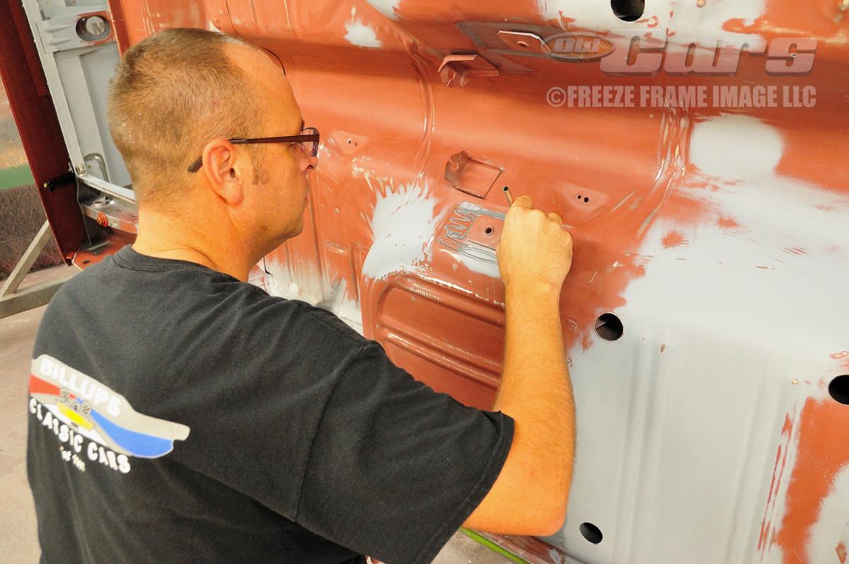 Jason Billups prepares the floor pan for the final paint application.