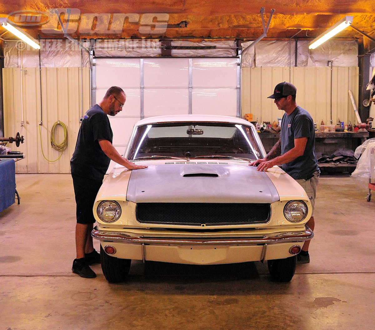 Jason Billups (left) and Skeeter White pre-fit the one-of-a-kind fiberglass Shelby 003 hood.