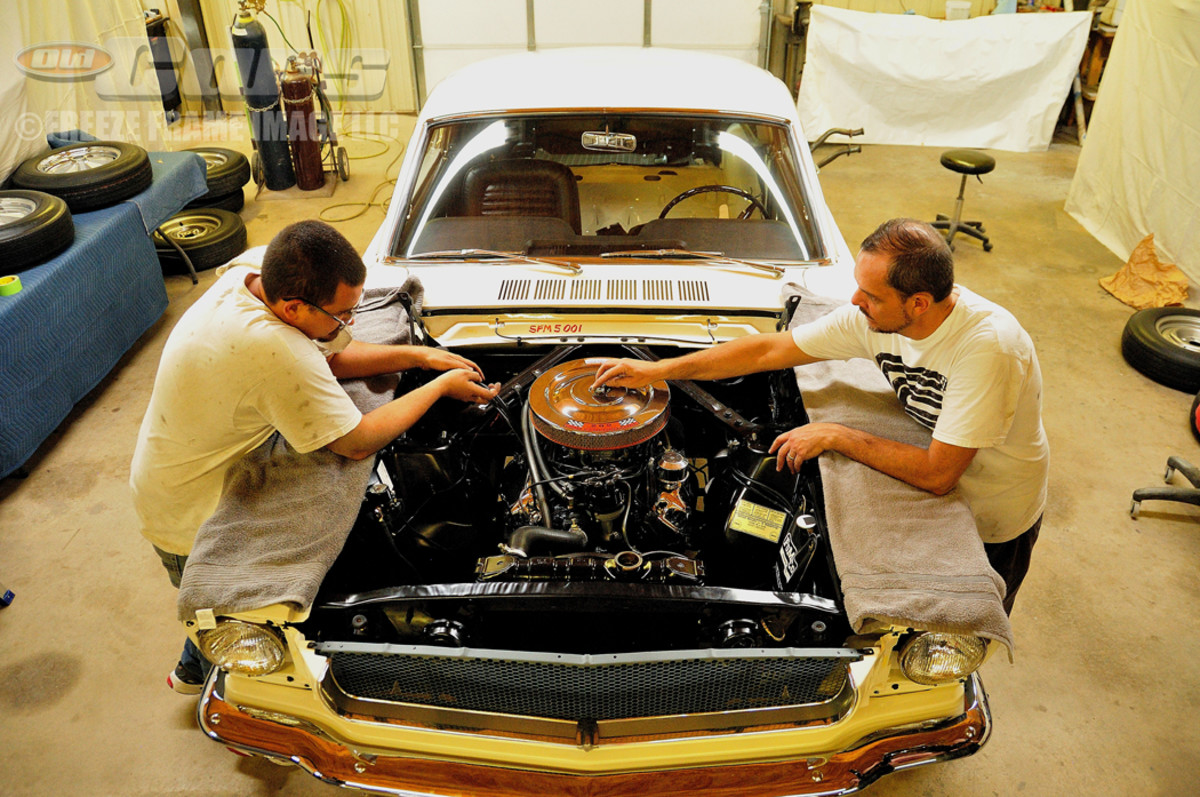 Kris Hague and Charles Turner start the process of removing parts for the 003 Shelby engine transformation from Ford Hi-Po 289 to Shelby GT350 specs.