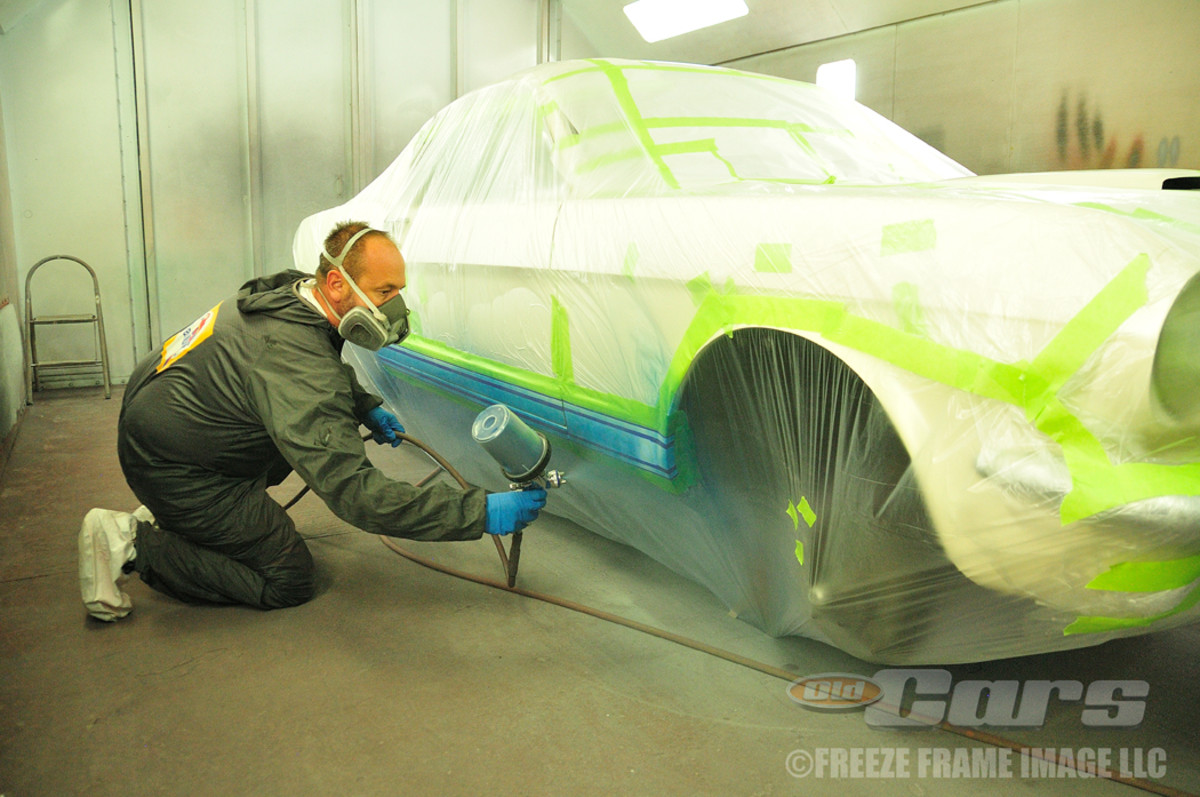 Jason Billups applies the single-stage Guardsman Blue paint as part of the Shelby GT350 003 package.
