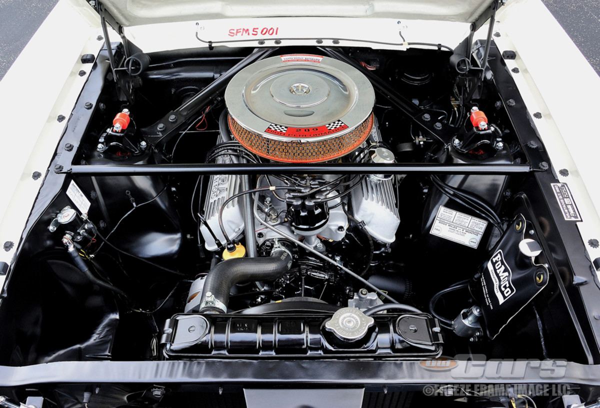 AFTER SHELBY GT350 - With Shelby modifications, including a new intake and Holley carburetor, the 289 produced 306 hp. Also note the aluminum Cobra valve covers and the Monte Carlo bar to stiffen the car.