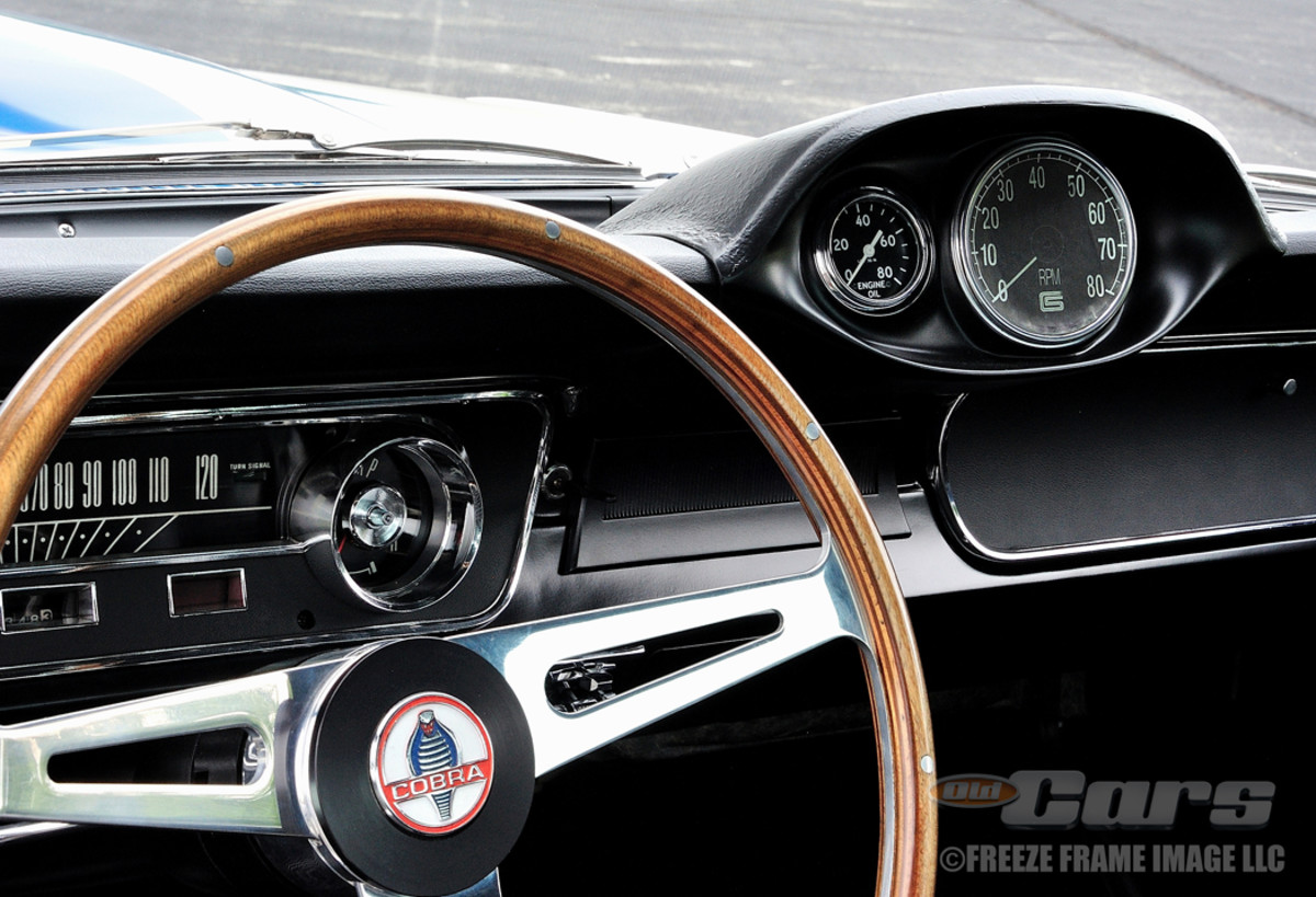 A close-up of the Shelby three-spoke steering wheel and special dash-top pod for the tach and oil pressure gauge.