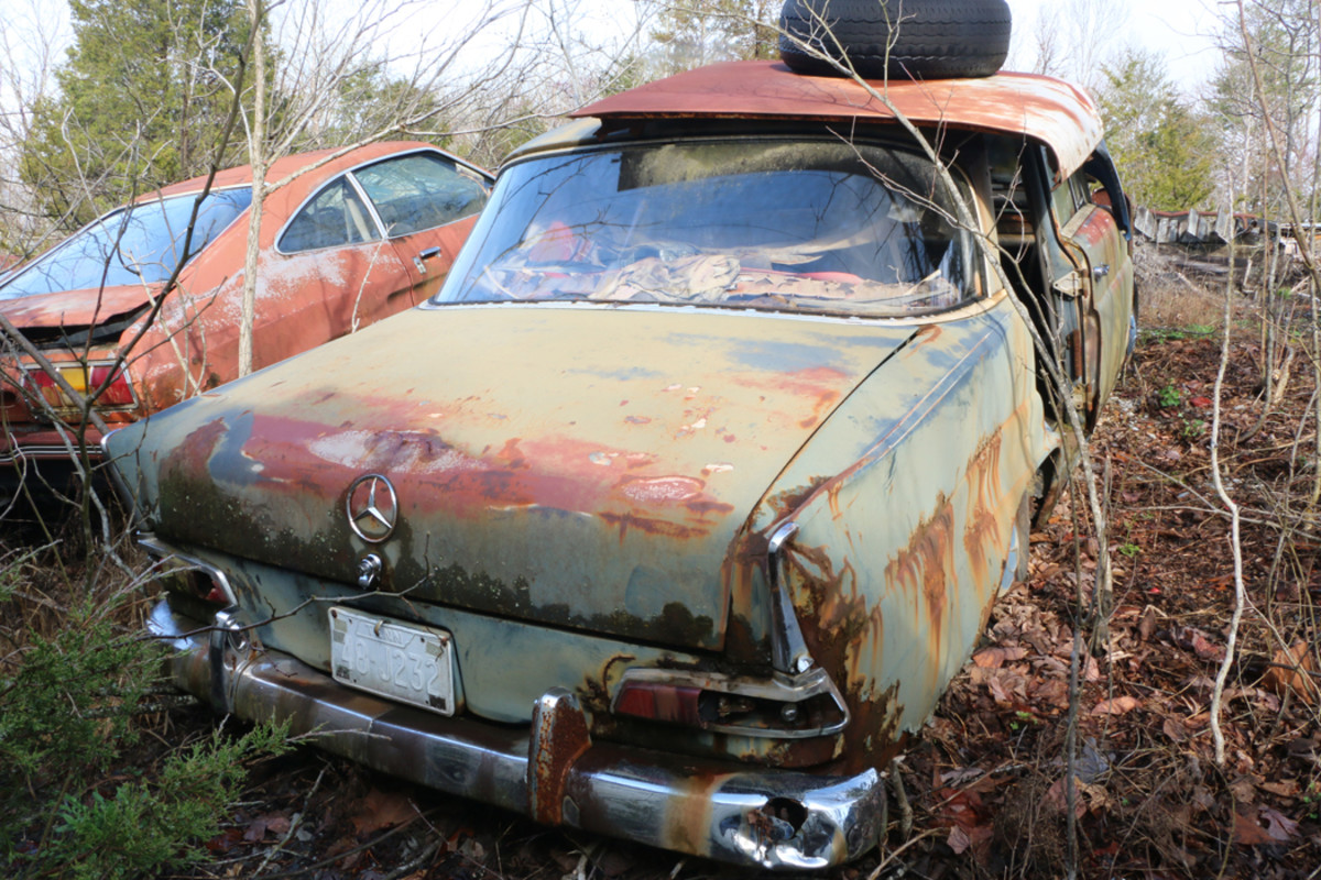 Ronnie described this car as a 1964 Mercedes with a four-speed transmission on the column and a four-cylinder diesel engine. Many parts have been removed, but some of them are stored in a nearby trailer. Ronnie says he has a perfect grille for it.