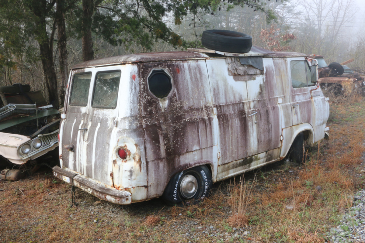 This 1964 Ford Econoline panel van was once used as  a camper. It ran when it  entered the yard. There is also a '66  Econoline van in the yard.