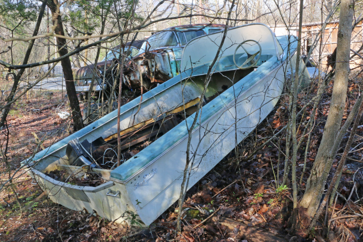 This Sea Sprite boat was built in Monmouth, Ill. Ronnie identified it as a '57 model, and we can envision seeing it restored and hooked to a Tri-Five Nomad painted the same color combination. There are other vintage boats scattered around the yard for sale.
