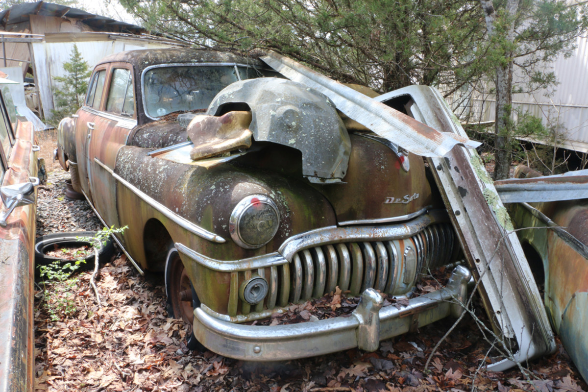 This 1950 De Soto DeLuxe was running when it was parked. A 1956 De Soto four-door sedan is parked nearby.