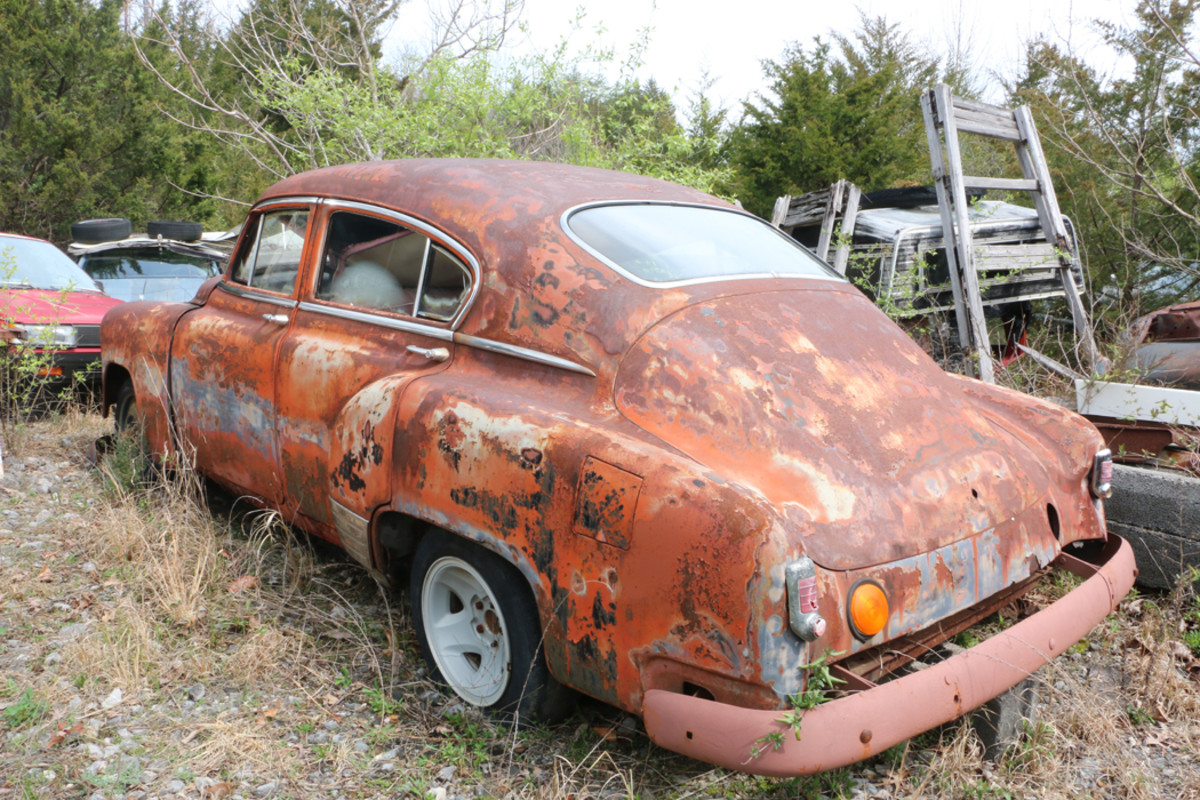 According to  Ronnie, this '51 Chevy fastback has a turbo 350,  subframe from a  '87 Chevy and power disc brakes. It also has tilt steering, console with shifter and upholstery that was once red, but now is more of a pink shade. Its fender skirts are in the trunk.