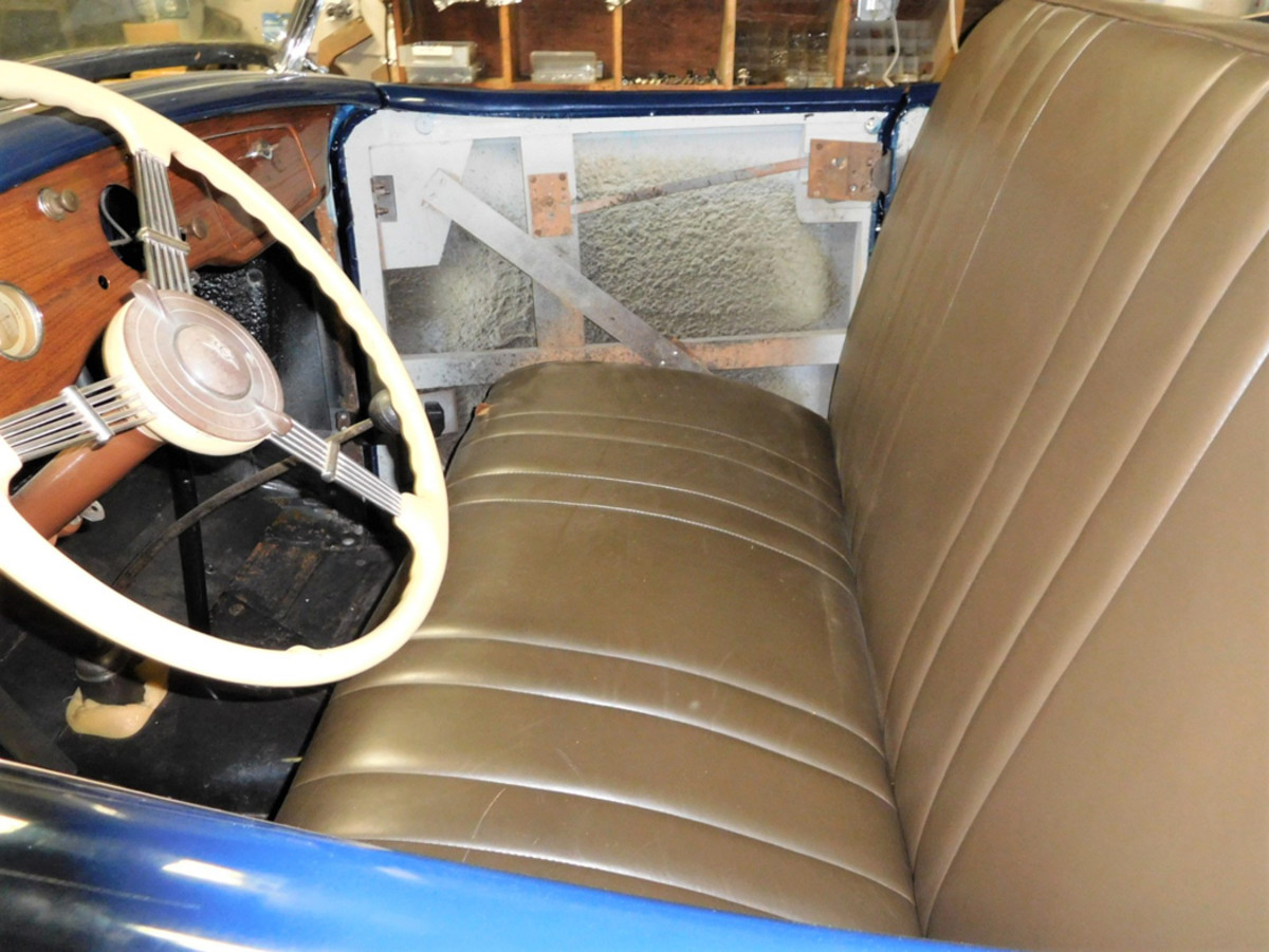 The interior has leather seats, a wood-grained dash and a banjo steering wheel.