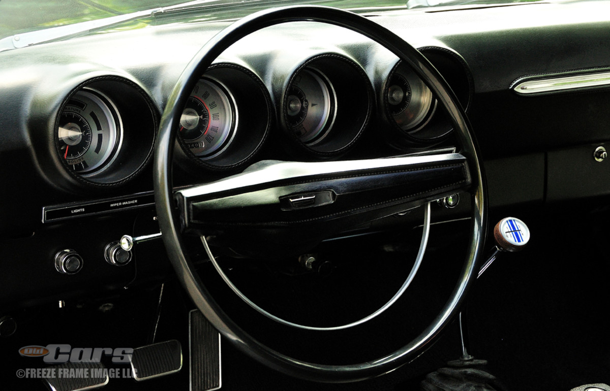 Inside, there's a black broadcloth vinyl bench seat. The shift handle to the close-ratio four-speed transmission bears a snake.