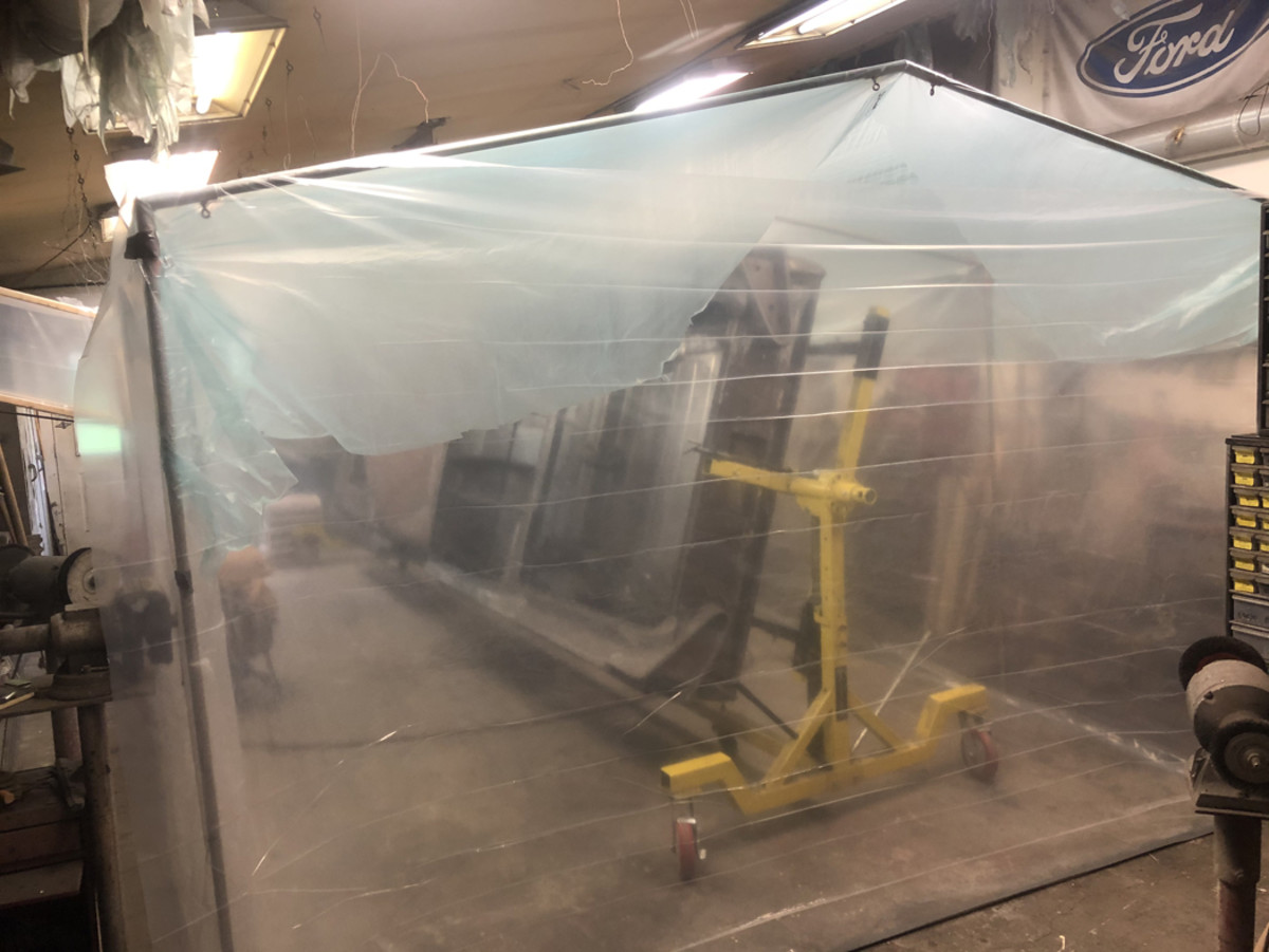 "I do the sandblasting in my shop and to contain the sand I erect a ""tent"" over the car using the same tubular framework you see over vendor spaces at swap meets. I wrap it with clear 4-mil poly and tape it to the floor. I have an exhaust fan in the side wall of the shop and I construct a ""duct"" to it from the tent."