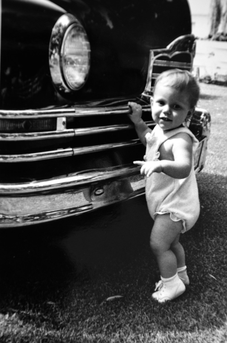 Debbie the toddler was introduced to a 1950 Packard when she was still shorter than the grille.