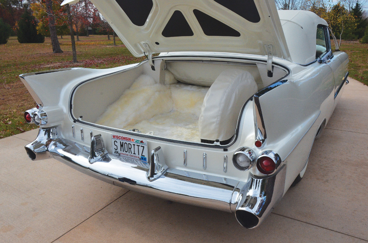 """In 1955, white Cadillac Eldorados had a red interior and trunk compartment. Since the """"St. Moritz"""" had a unique white interior, its trunk compartment was finished in white to match the interior. The result is unique white panels and a mouton-carpeted floor."""