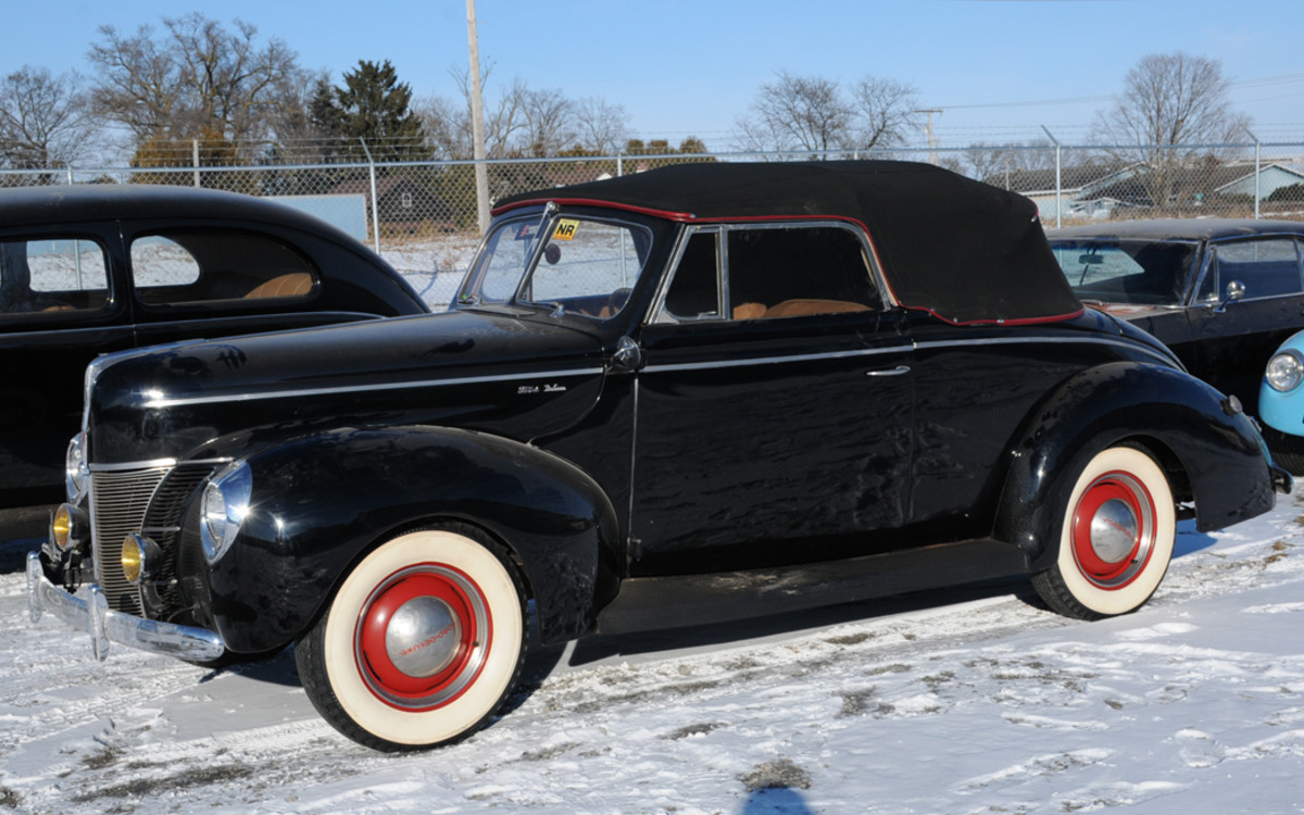 """This 1940  Ford Deluxe  convertible was  a nice No. 3  """"driver"""" with plenty of  potential. It sold for $27,000 at Kraft Auctions' Antique and  Collectibles Sale in Valparaiso, Ind."""