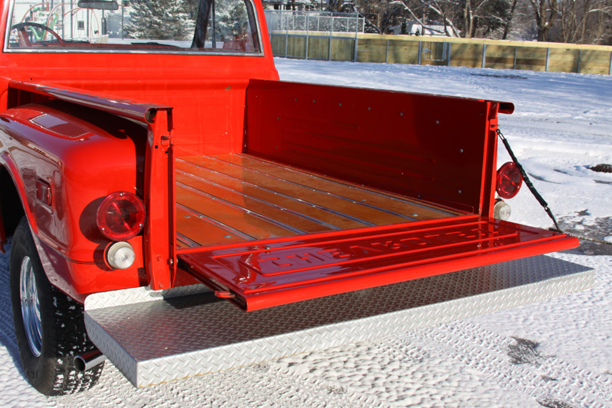 The bed has a beautiful wood floor. The tailgate was not used during the truck's in-service years so it was in great condition when it was reinstalled during the truck's repaint.