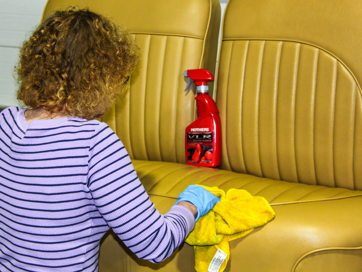 Michelle Desch begins initial cleaning for the vinyl-upholstered seat. She's taking a shine to Mothers VLR, formulated for use on vinyl, leather and/or rubber. As the vinyl is dried with a microfiber towel, it's looking and smelling real nice.