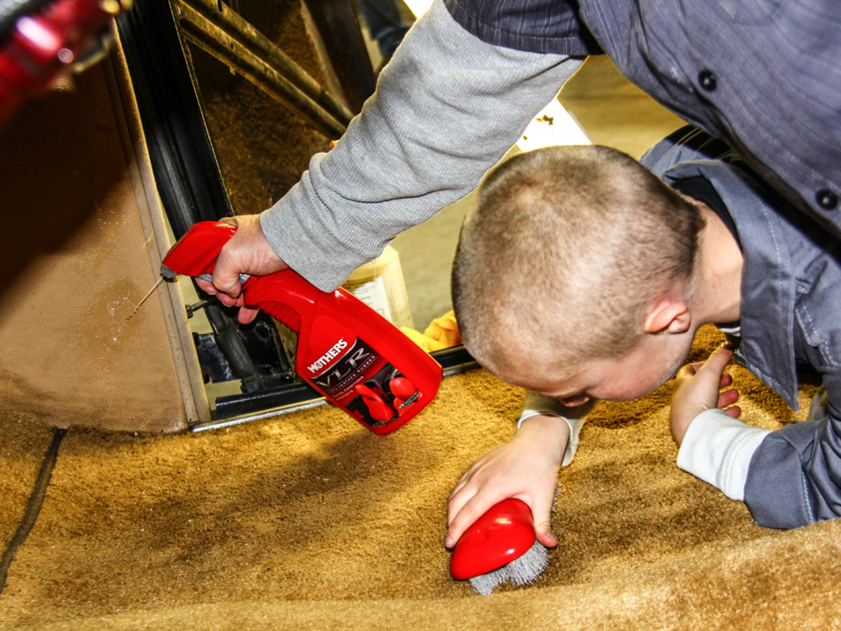 Making use of Mothers Carpet & Upholstery cleaner, VLR, and the appropriate brush, the Colbys collaborate to save soiled carpet and kick panels.