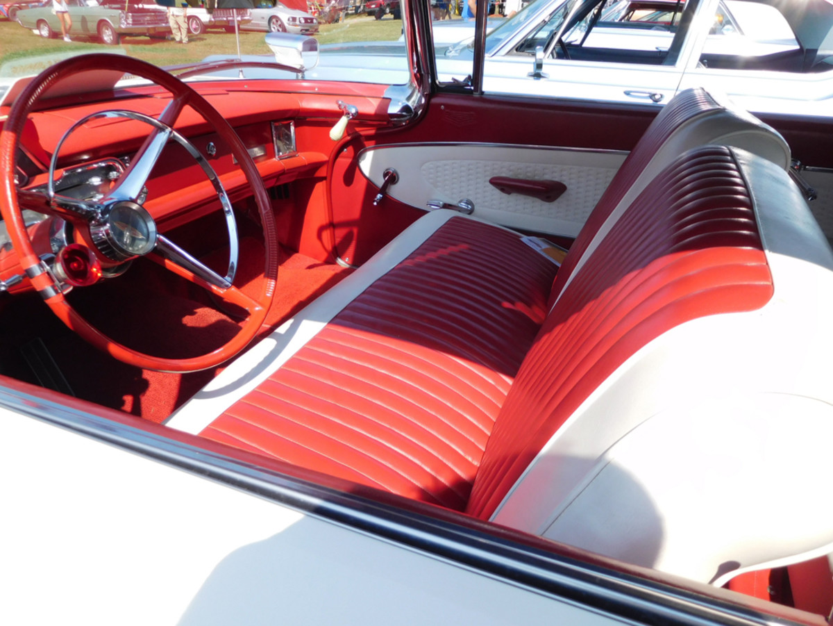 This car has wind-up windows, but power window lifts were an available option. Convertible tops came in white, black, tan, light blue and light green.