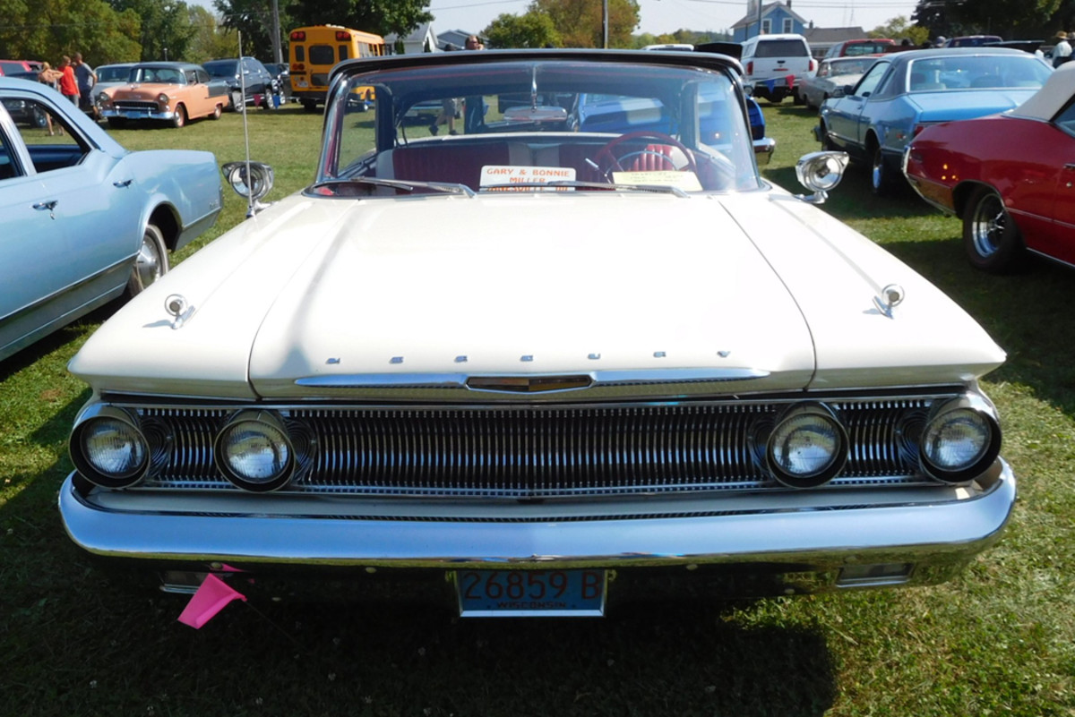 A wraparound windshield was standard and considered a safety feature. Mercury even offered a belt-driven windshield washer (not on this car) as an extra-cost option.