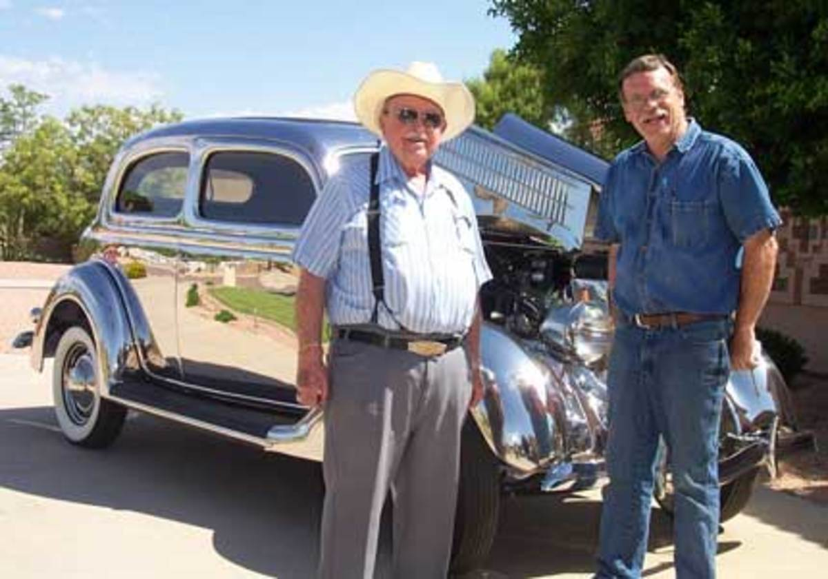 In this file photo, Leo Gephart (left), owner of Gephart Classics in Scottsdale, Ariz., and Lon Krueger (right) stand with the 1936 stainless-steel Ford they co-owned.