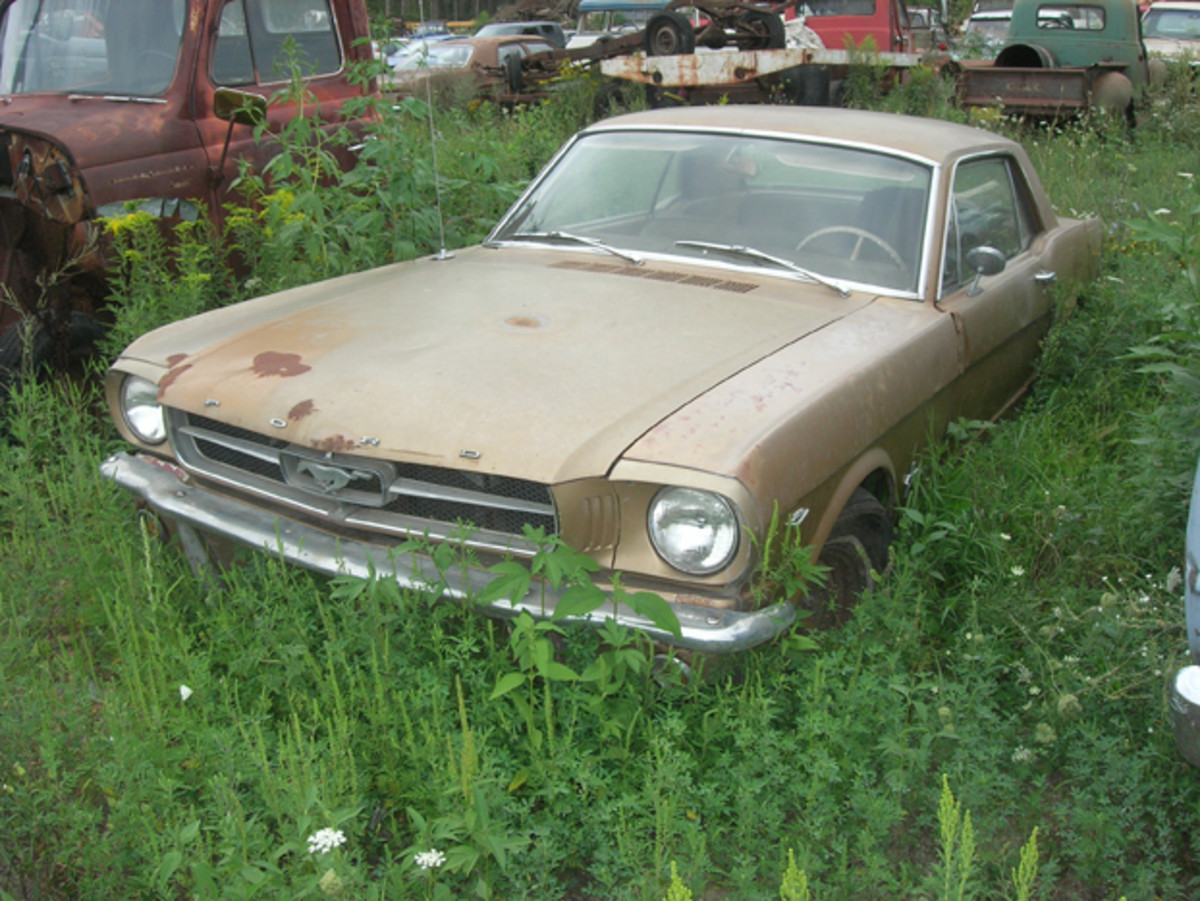 Manthey Salvage contains a handful of first-generation Ford Mustang hardtops (no fastbacks). This example is equipped with the rare four-speed manual transmission, but has some rust issues.