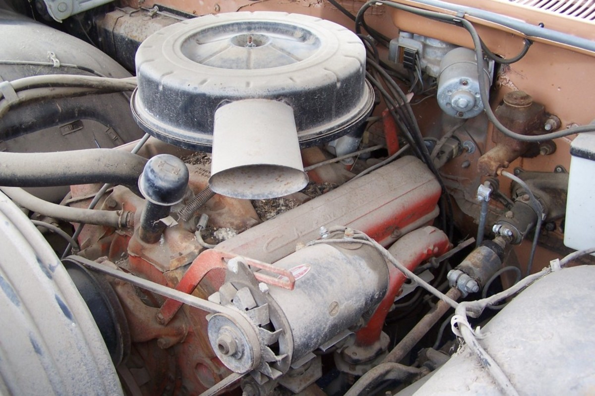 The dusty 283-cid V-8 in the 2-mile 1959 Bel Air, before Smith began cleaning the car. Note the overspray of Chevy orange paint on the exhaust manifold.