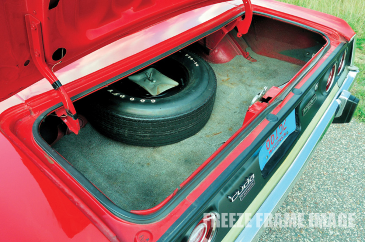 The' Cuda still has its original bias-ply tires on its Rallye road wheels, which were optional at $53.40. The spare was a steel wheel, however.