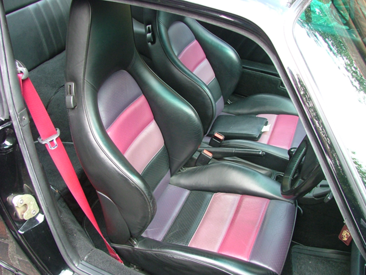 The black interior features Sport leather seats with triple color inlays.