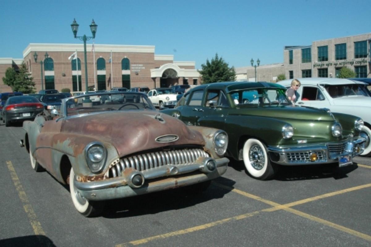 An odd pairing of postwar Milestone cars: a rough 1953 Skylark and a mint 1948 Tucker at the Wisconsin Auto Museum during a Kaiser-Frazer meet.
