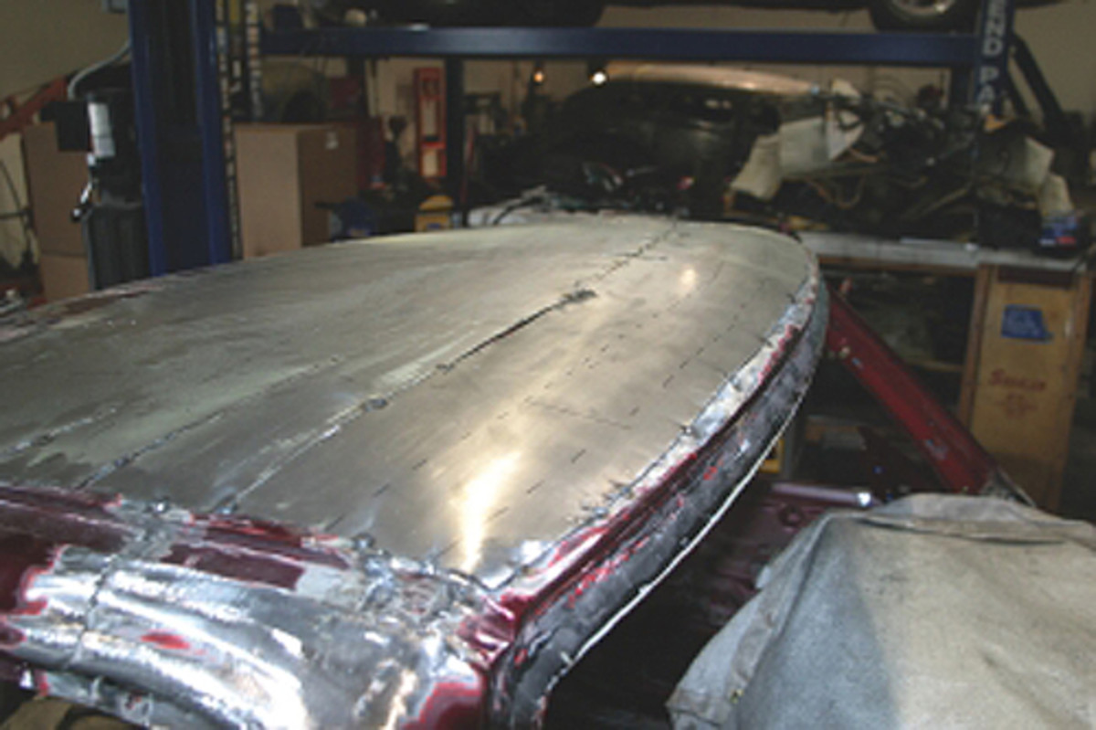 We filled this sunroof in with metal, which required shaping a piece of metal on the English wheel and welding it into place. Once again, we used a TIG welder to minimize warping.