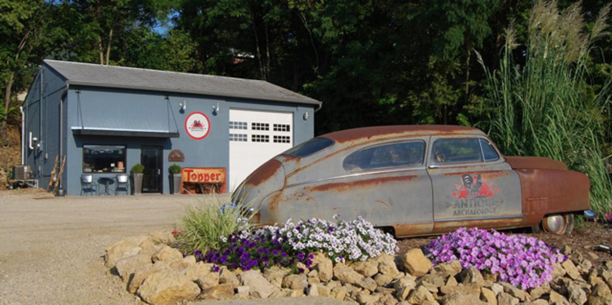 "A rusty old ""bathtub"" Nash stood as a silent sentinel outside the original Antique Archeology location in LeClaire, Iowa.."