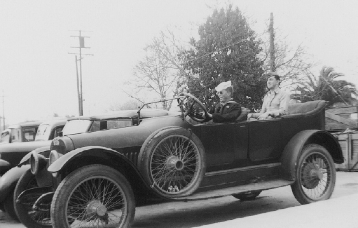 Neither the big touring car or its passengers are known to me, but one thing's for sure -- it's a grand old car. Also notice the rare 1936 Ford convertible sedan next to it.