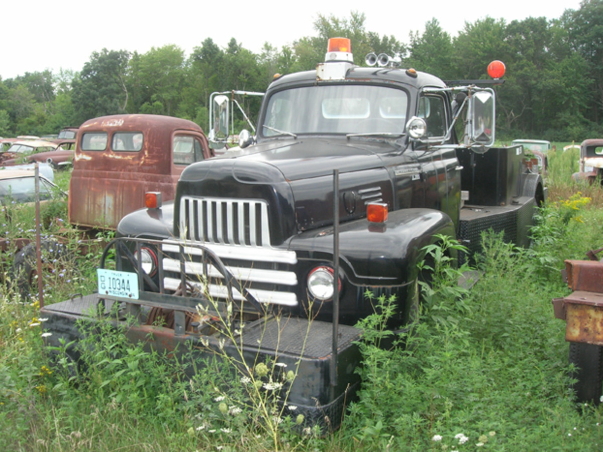 "The ""mystery"" vehicle of Manthey Salvage is this early-1950s International L185 Roadliner wrecker. Someone spent a lot of time and money performing a total restoration on this tow truck, and then abandoned it in the yard. It lacks nothing except a new owner to rescue it from oblivion."