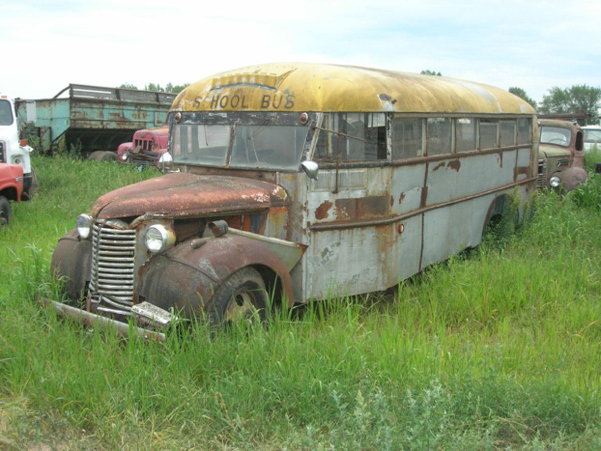 Vintage big trucks are staged in a separate section of the yard, and included in the group is this 1940 Chevrolet school bus. With some work, this rig could be converted into a one-car hauler for a dual display at a car show.