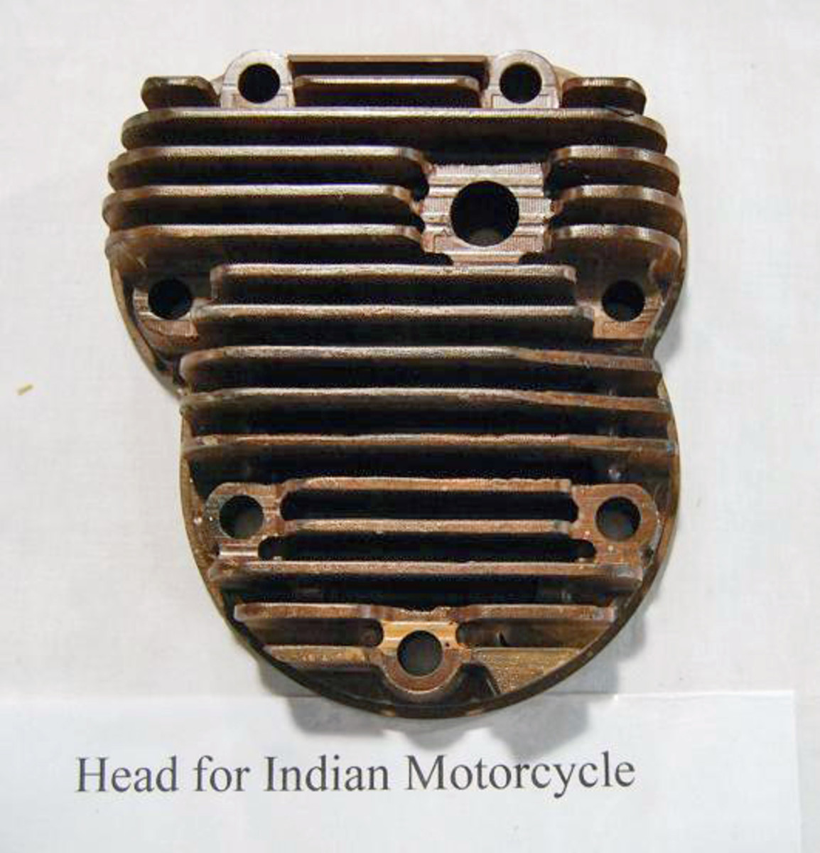 This is a wooden pattern for a vintage motorcycle cylinder head.